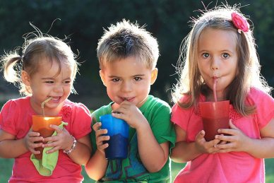 Healthy kids drinking smoothies